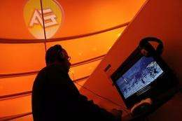 A fair goer plays a game by Electronic Arts (EA) at an entertainment fair
