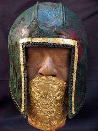 A handout photo shows a warrior's bronze helmet with gold mouth protector dated to the 6th century BC