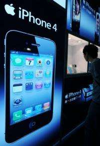 A man looks at the iPhone 4 through a display in Taipei