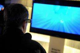 A man watches a 3D TV