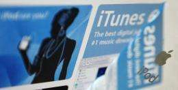 Apple's iTunes website is reflected on an iPod music reader