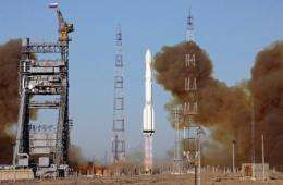A Proton-M rocket carrying the Russian Glonass-M satellites blasts off