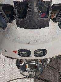 Astronauts hoist cargo carrier onto space station (AP)