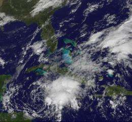 GOES-13 sees system 99L organizing tropically