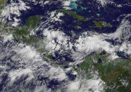 GOES-13 sees tropical depression 15 form in the south-central Caribbean Sea
