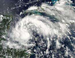 Quick-intensifying Tropical Storm Karl landfalling in Mexico