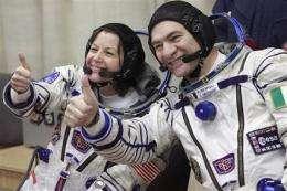Soyuz crew blasts off on space station mission (AP)
