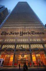 The New York Times' masthead is displayed in front of the midtown headquarters