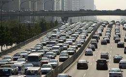 Vehicles drive on the road through the central business district in Beijing