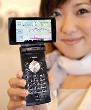 """A model displays a """"Stock mobile phone"""" produced by Sharp"""