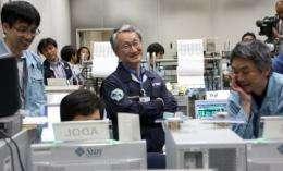 JAXA personnel celebrate after a Hayabusa spacecraft probe lands in Australia