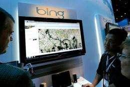 Microsoft's Roger Wong (2nd R) demonstrates maps using Bing