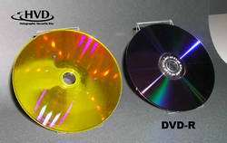 Holographic Versatile Disc™ (HVD™) on which digital movies were recorded (left). The disc diameter of 12 centimeters is equivale