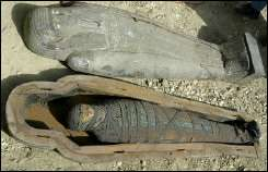 Open coffin and a mummy at an excavation south of Cairo