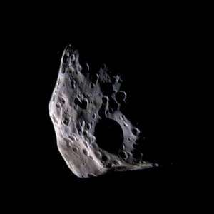 Cassini Captures Swiss-Cheese Look of Saturn Moon