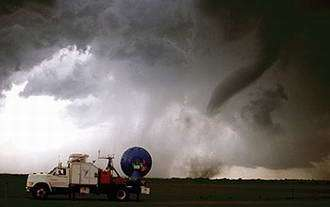 Rapid-Scanning Doppler on Wheels Keeps Pace with Twisters