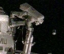 Expedition 10 Flight Engineer Salizhan Sharipov deploys Nanosatellite. Credit: NASA.