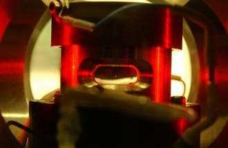 A single grain of moondust hangs suspended in Abba's vacuum chamber
