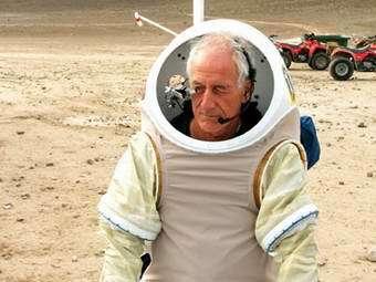 MIT Professor Jeffrey Hoffman tests a Hamiliton Sundstrand concept spacesuit