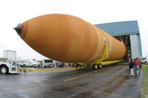 Space shuttle external tank ET-119 rolls out at NASA's Michoud Assembly Facility near New Orleans