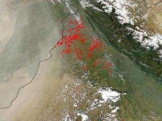 Hot dust and moisture collide to fuel Asian summer rainy season