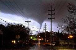 A tornado moves through a small town