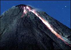 Hot lava runs down from Merapi volcano