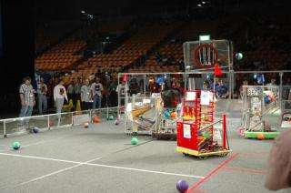 Student-build robots compete in FIRST's regional basketball tournament