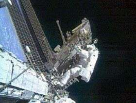 Astronauts Move Carts, Upgrade Communications System; Spacewalk Continues