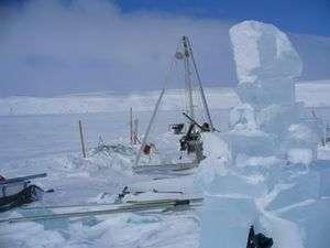 Arctic Impact Crater Lake Reveals Interglacial Cycles in Sediments
