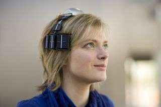 Wireless EEG system self-powered by body heat and light