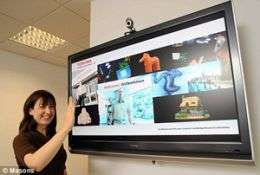 A hand signal pauses the new TV