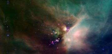Spitzer Catches Young Stars in Their Baby Blanket of Dust