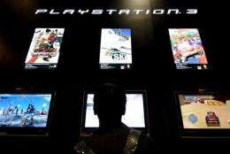 A man tries a game for Sony's game console Playstation 3