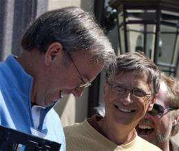 Google, Microsoft chairmen share laugh together (AP)