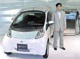 "Mitsubishi Motors President Osamu Masuko introduces the company's first mass production electric vehicle ""iMiEV"""