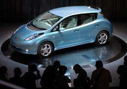 "Photographers take pictures of the new Japanese Nissan Motor's electric vehicle called ""Leaf"""