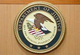 The seal of the Department of Justice