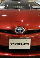 The world's biggest car-maker Toyota Motor has said it plans to begin commercial sales of its first plug-in hybrid car