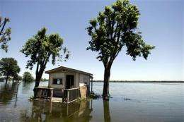 Global warming may require higher dams, stilts (AP)