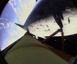 Astronauts inspect space shuttle for launch damage (AP)