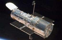 Atlantis astronauts warily eye landing-day weather (AP)