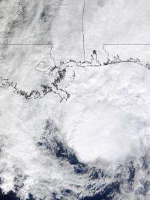 NASA satellites see Ida spreading out before landfall