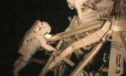 Astronauts get extra work done in 1st spacewalk (AP)