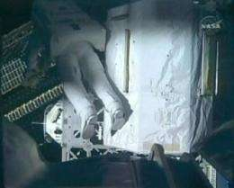 Astronauts take spacewalk No. 3 after suit snag (AP)