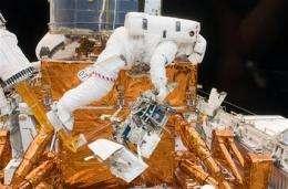 Spacewalkers pull off toughest Hubble repairs yet (AP)