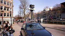 A Google Street View car with its camera in Amsterdam