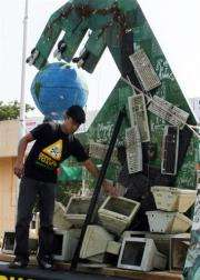 A Greenpeace stands by an installation made from hazardous e-waste in New Delhi