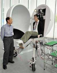"A Japanese professor presents his virtual reality machine ""Media Vehicle"" at the expo in Tokyo"