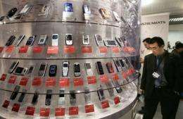 A man looks at mobile phones displayed in Cannes, southern France